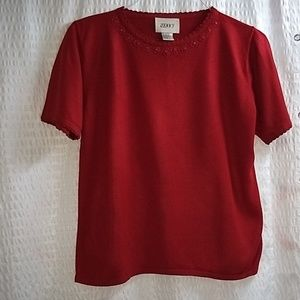 Red short sleeve blouse with embroidered neck